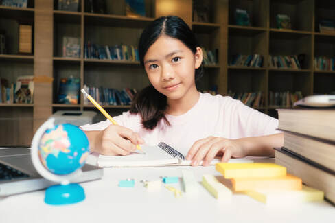 Girl enjoying hands-on enrichment class in singapore